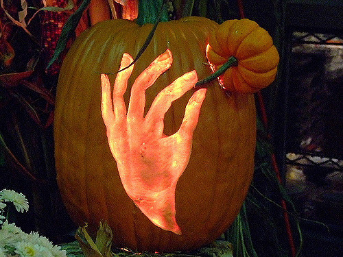 hand holding a pumpkin carving
