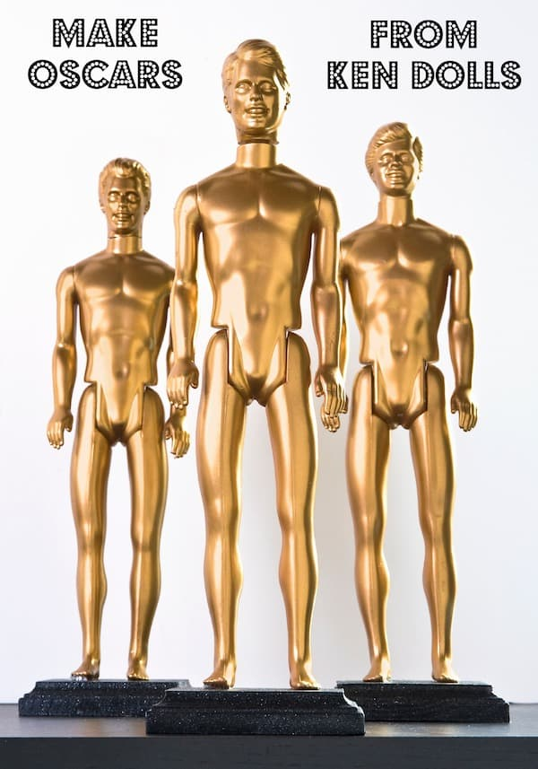 Create DIY Oscars using Ken dolls - it's easy to make them with spray paint and wood plaques. Perfect for Oscar parties or photo booths!