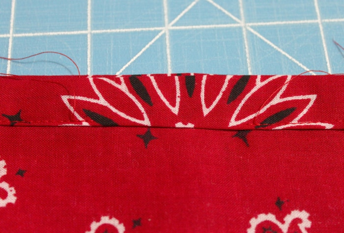 Sew the cut edge down
