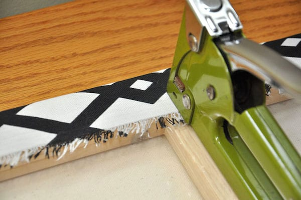 Staple fabric to the canvas edge with a green staple gun