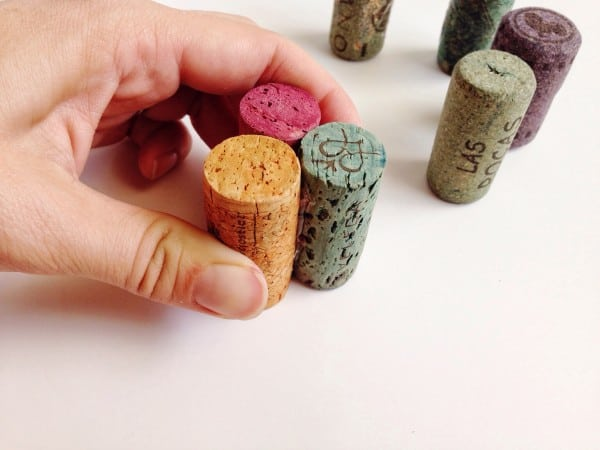 Pressing hot glued wine corks together to make a pincushion