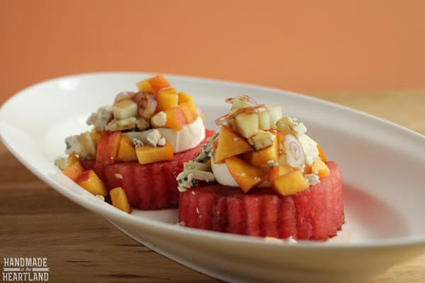 This watermelon salad recipe is full of flavor! The peaches and cucumber give it sweetness and crunch; and the cheese and shallots are a perfect addition.