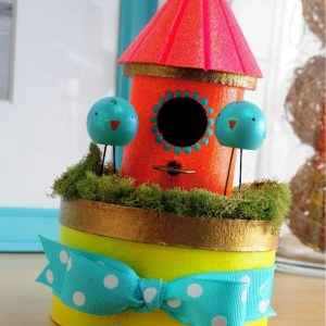 This DIY birdhouse project is so perfect for spring! Decorate the top of a box with bright colors and glitters, and store goodies inside.