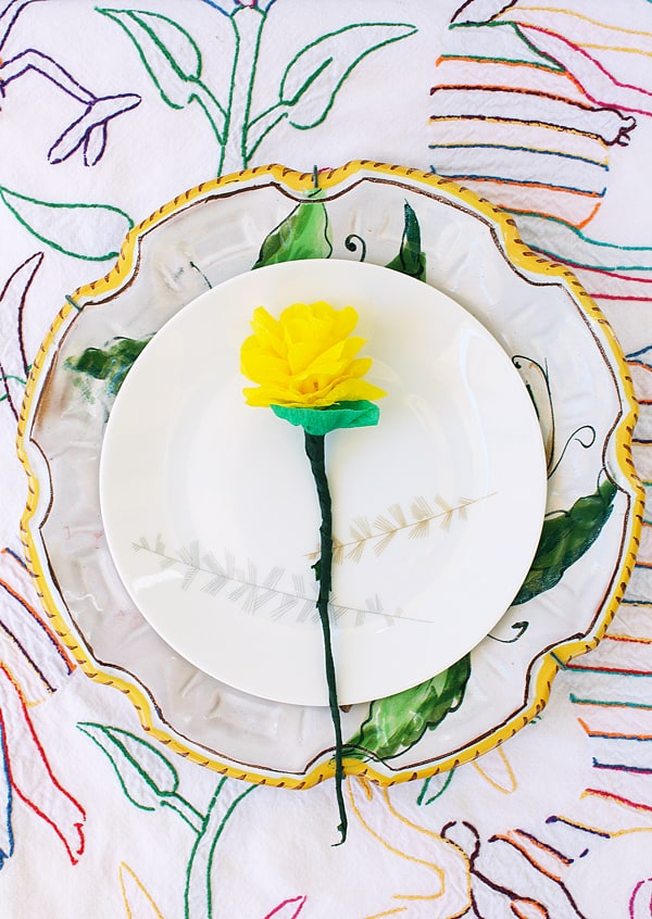 DIY crepe paper flower in the center of a white plate