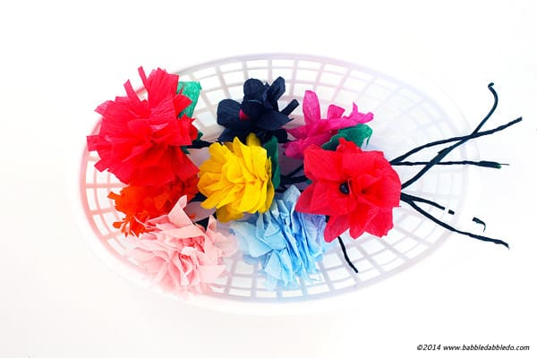 Learn how to make paper flowers from crepe AKA streamers. Oh and did I mention they take 5 minutes?