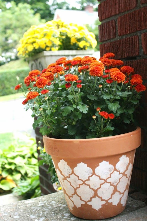 Learn how to use a stencil to make clay pots pretty for fall
