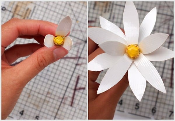 11 then use a scissor to cut out the petal shapes and use the craft