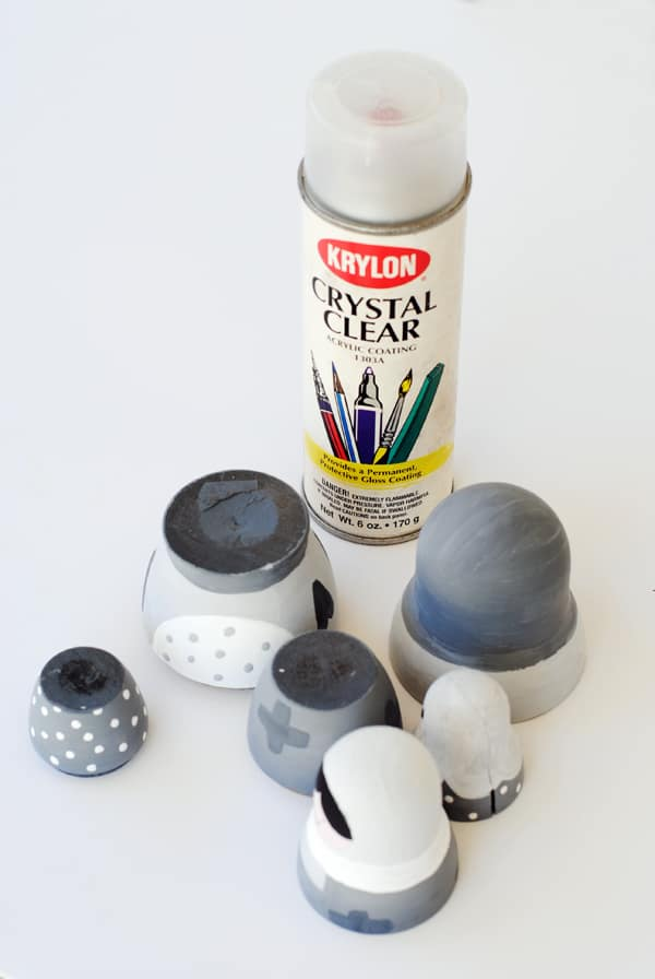 10 - applying a coat of clear acrylic to nesting dolls