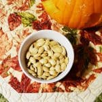 It's so easy to bake pumpkin seeds in the oven and add a few ingredients to make them delicious - learn how with this tasty roasted pumpkin seeds recipe!
