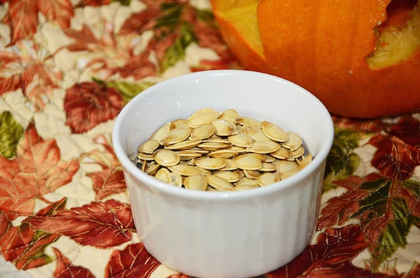 It's so easy to roast pumpkin seeds and add a few ingredients to make them delicious - learn how with this tasty pumpkin seeds recipe!