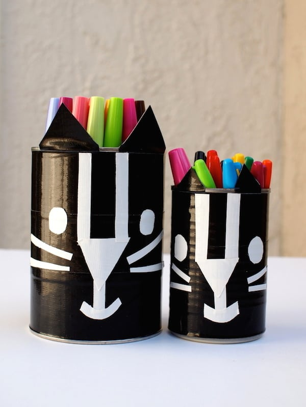 Learn how to make these black cat containers with duct tape - kids will love this Halloween craft!