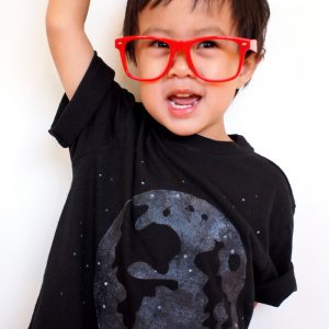 Make a glow in the dark t-shirt with an image of the moon using this easy tutorial - all you need is some glowing fabric paint.