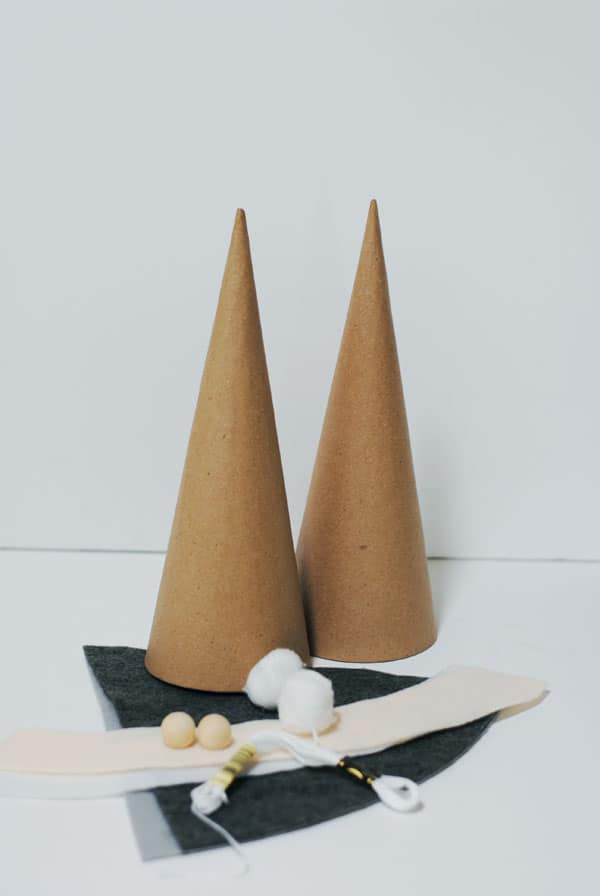 Paper mache felt cones, felt, embroidery floss, cotton balls, wood beads