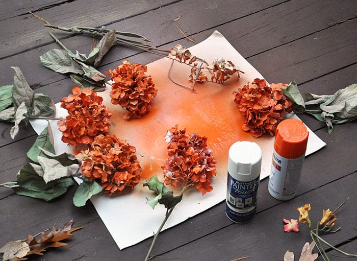 If you can't find fake flowers in the colors you need or just want a change, paint them! Here's how.