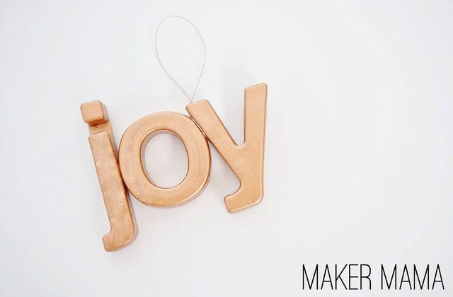 Do you have an excess of plastic magnet letters that you don't know what to do with? Turn them into these metallic DIY ornaments!