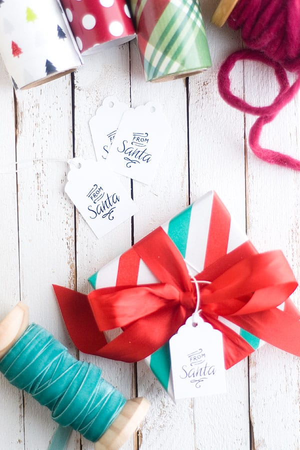 "These free printable Christmas gift tags that say ""From Santa"" are very simple yet pretty. Dress up a gift with any kind of paper in minutes!"