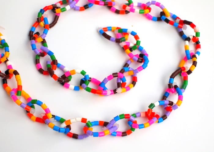 This unique Christmas tree garland made from perler beads looks so awesome on a tree! You can make it in minutes and it's great for any celebration.