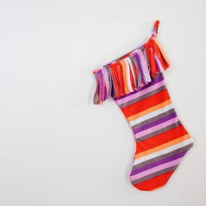 This easy DIY Christmas stocking was made from an old pair of fleece pants. You can sew it up in about 15 minutes!