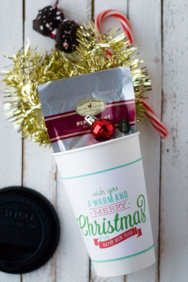 Trying to figure out some great ideas for neighbor gifts? This warm and and merry cup with a free printable sleeve can be filled with anything!