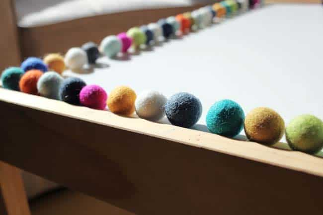 Felt ball garland - arranging the felt balls