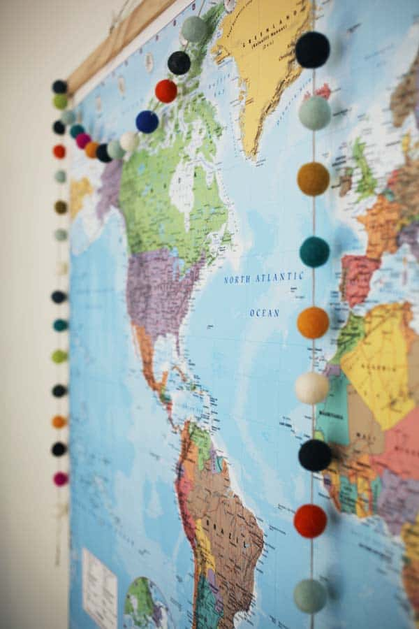 Felt ball garland displayed on a map