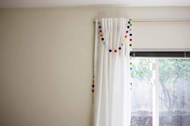Felt ball DIY garland on a living room curtain