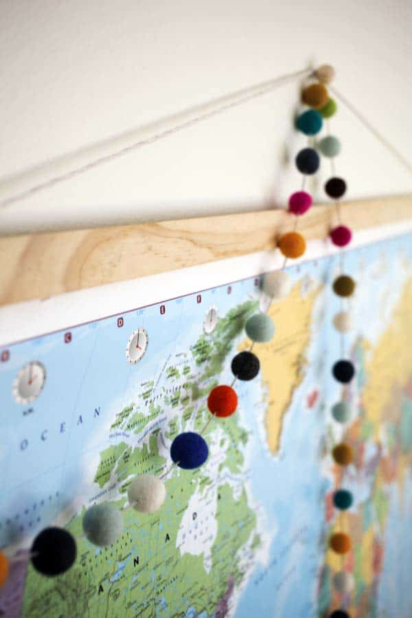 Felt ball garland hanging from a map
