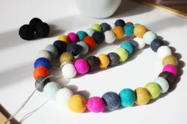 felt balls on embroidery floss without spaces