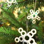 Use small washers from the hardware store to make these cute DIY star ornaments - kids will love making them with you, and they are so inexpensive!