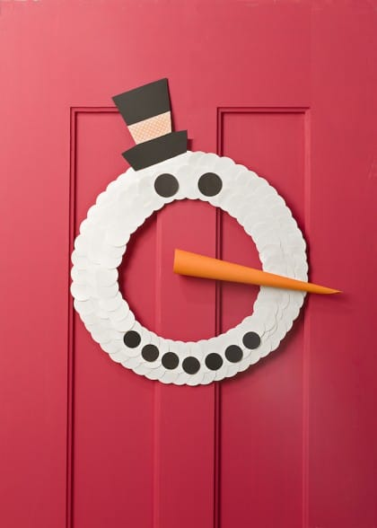 This snowman craft won't melt on warm afternoons! Make this cute wreath using paper punches - kids will love it!