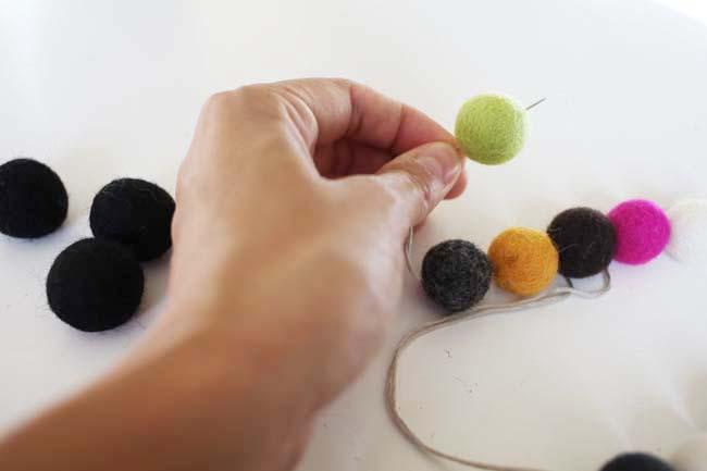 Felt ball garland - stringing the felt balls