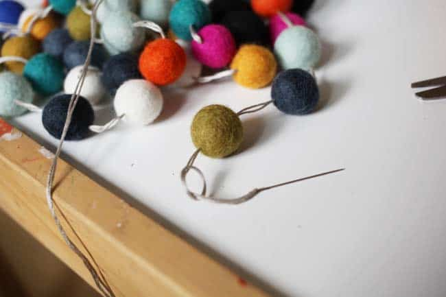 tying knot at end of felt ball garland