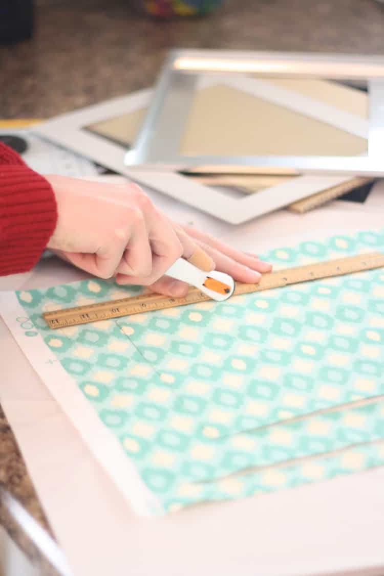 Woman cutting fabric using a cutter and a ruler