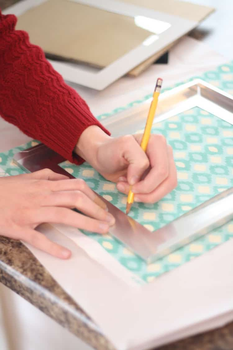 Trace the frame on fabric with a pencil