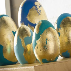 These painted Easter eggs are a unique way to decorate for the holiday - add bright paint colors and gold leaf. Use real Easter eggs or faux!