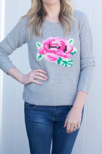 Learn how to make this adorable and easy DIY cross stitch floral sweater for under $10! Perfect for personalizing your own fashion.