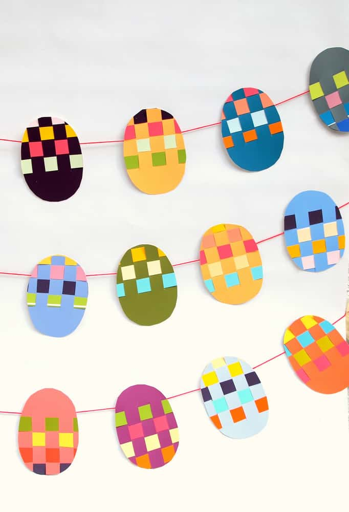 You can make this easy Easter banner out of old paint chips - and children will love it; this project teaches them to weave!