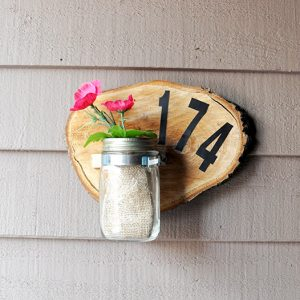 Learn how to make a unique house number sign from a wood slice - this is such a great home decor project, and on a budget!