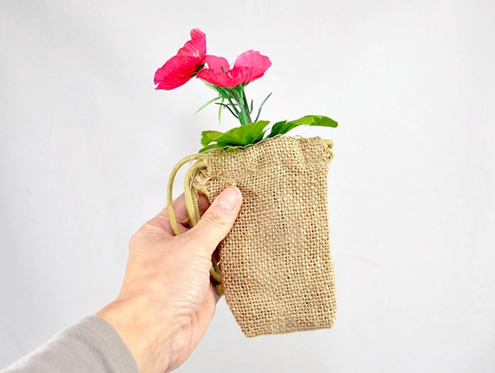 Faux flowers wrapped in burlap