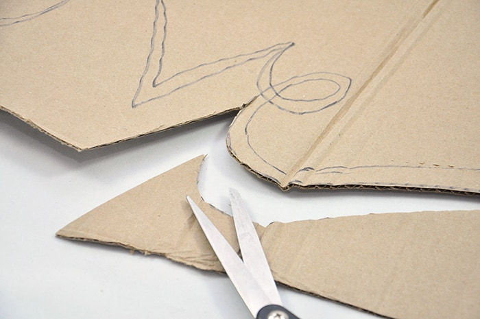 Cutting cardboard with scissors