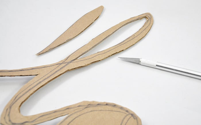 Cutting cardboard with a craft knife