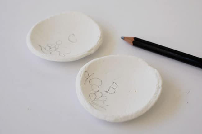 drawing-floral-pattern-on-air-dry-clay-ring-dish
