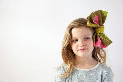 Raid your fabric stash, or the thrift store, and see how to make your own giant no-sew DIY bow to brighten up your day.