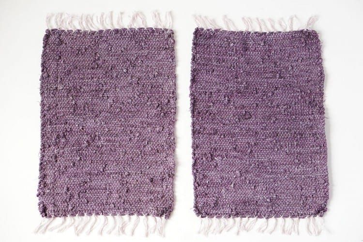 Two purple placemats laying next to each other