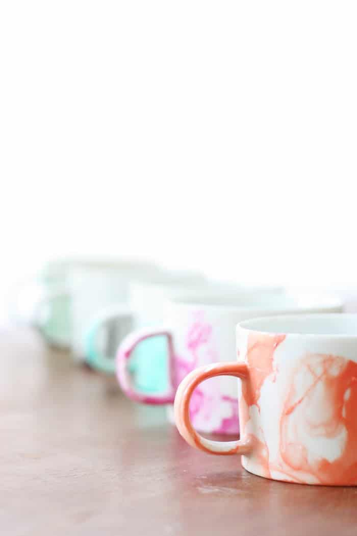 Set of DIY mugs made with nail polish