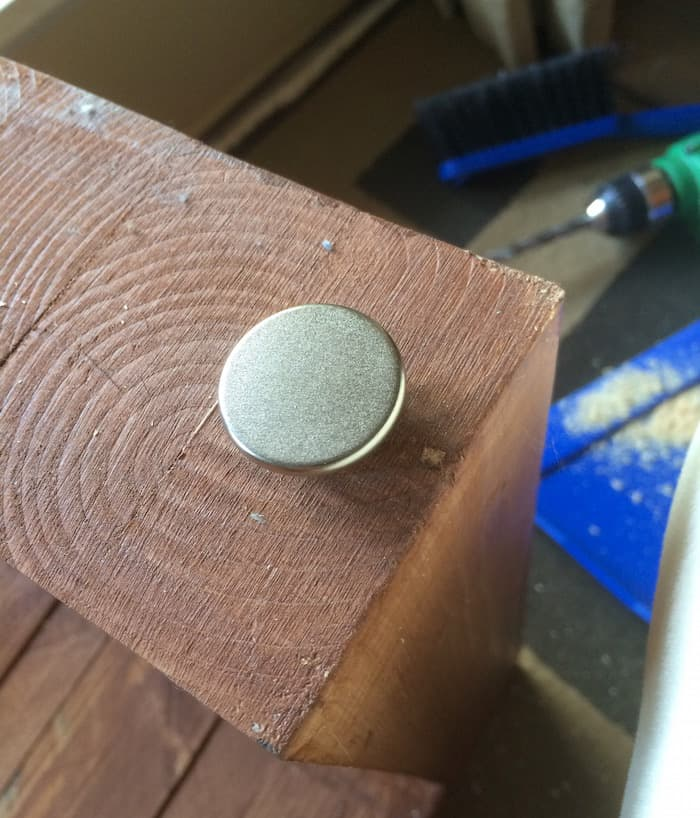 Bottom of a DIY outdoor bench with feet