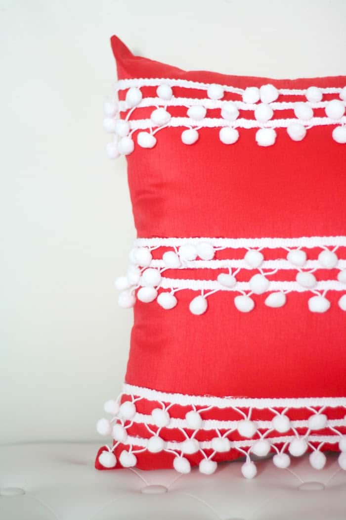 Add pretty details and a pop of color to any room with a simple no sew pillow project - then add pom pom trim to make it really fun!