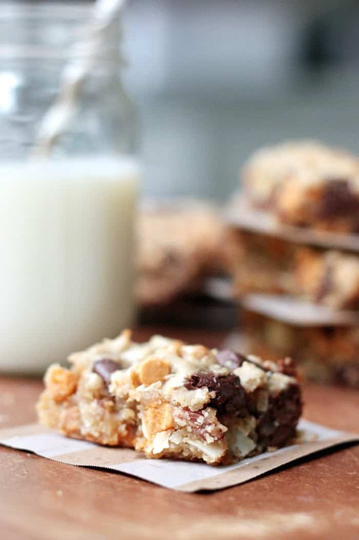 Blonde brownie recipe with a glass of milk in the background