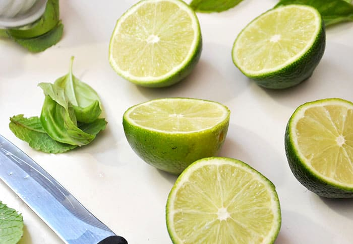 Five cut limes and a knife