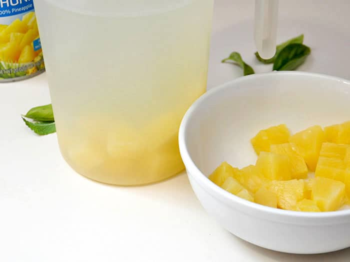 Stir pineapple chunks into the pitcher